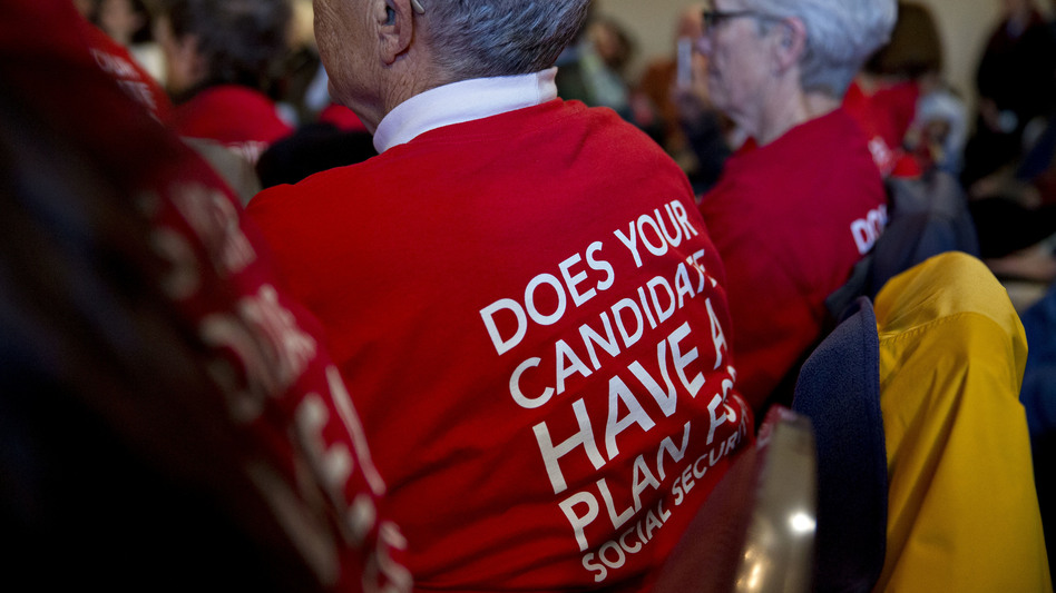 Attendees wear t-shirts in support of presidential candidates committing to Social Security for all generations during a town hall meeting in Cedar Rapids, Iowa, on Jan. 29. (Andrew Harrer/Bloomberg via Getty Images)