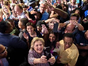 Democratic presidential nominee Hillary Clinton takes a selfie with supporters after speaking at a rally about national service on September 30 in Fort Pierce, Fla.