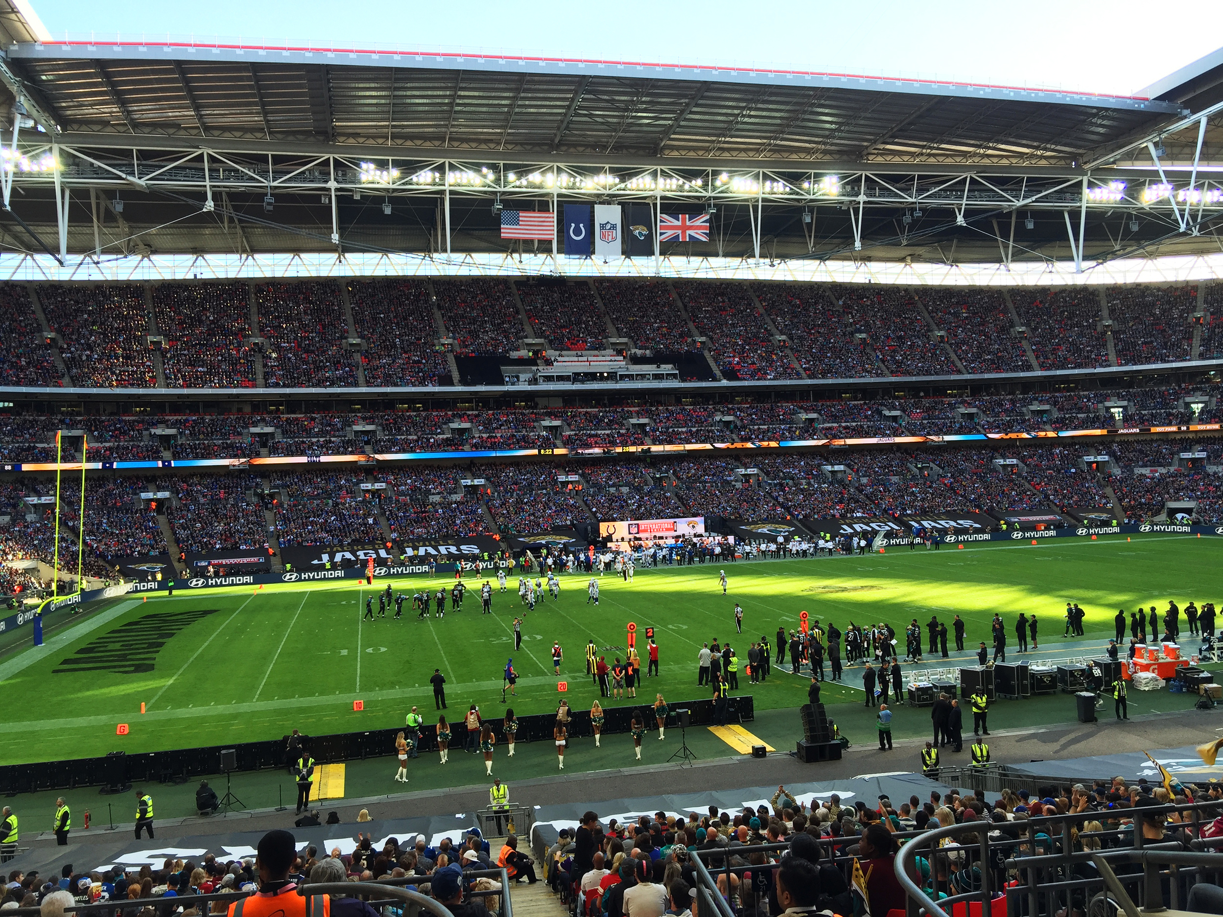 Thousands of fans wearing jerseys representing all 32 NFL teams attend opening day of the NFL's International Series at London's Wembley Stadium on Sunday. Frank Langfitt/NPR.