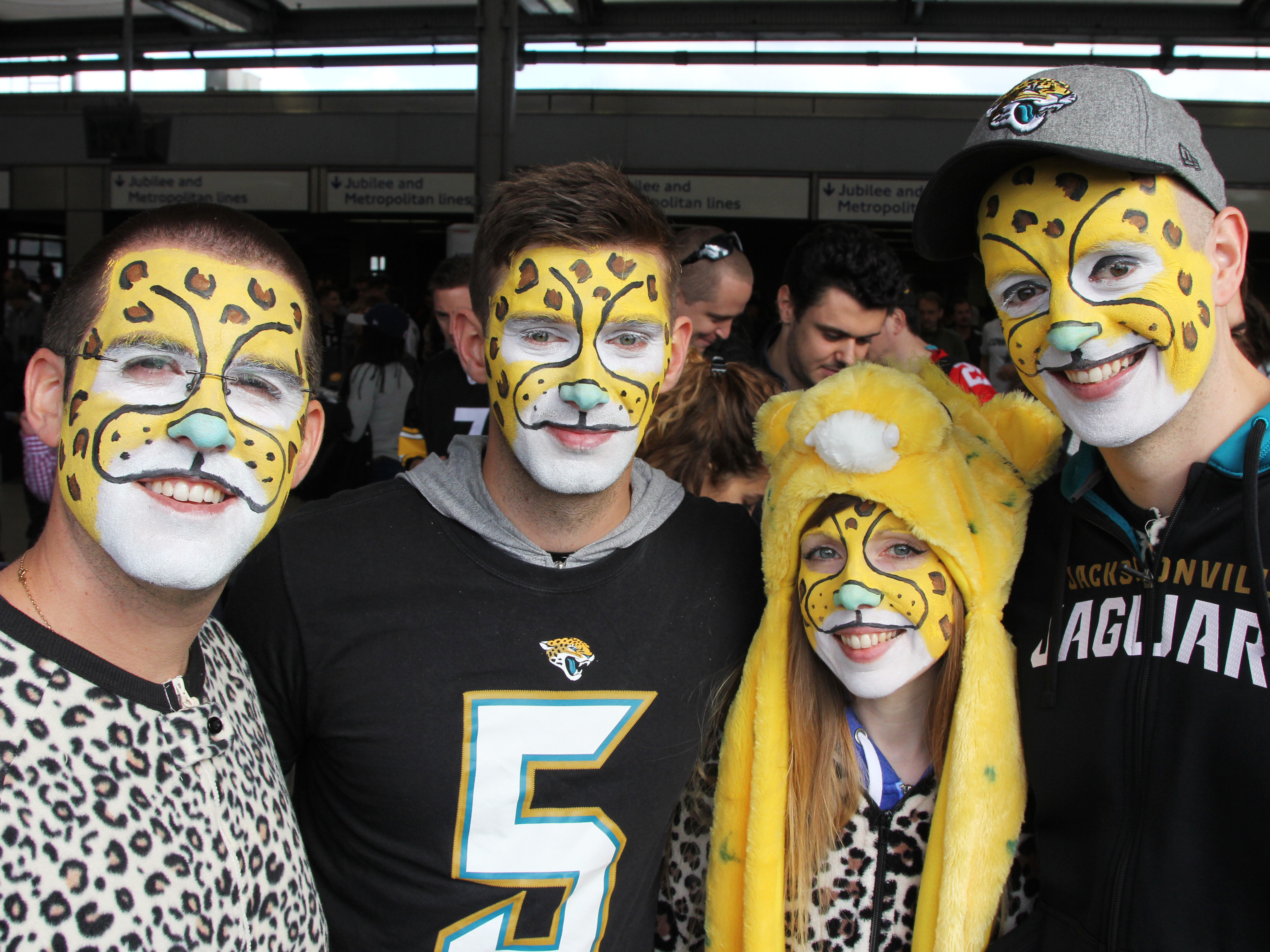 Fans from the English city of Reading don Jacksonville Jaguars onesies to cheer on the team, which has committed to playing games in London through at least 2020. Frank Langfitt/NPR.