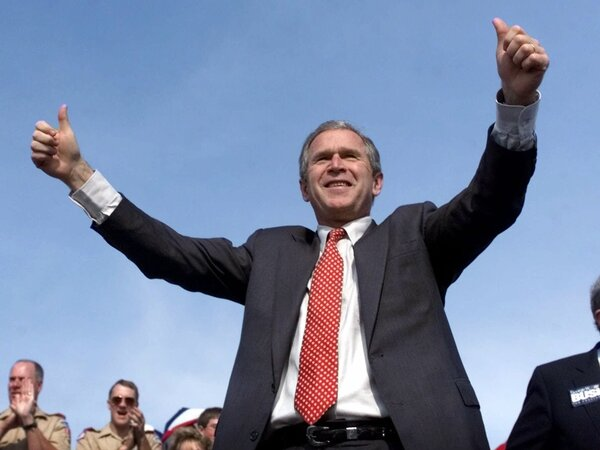 George W. Bush, then as Texas governor, running for president at a rally in Missouri, Oct. 28, 2000. That was days before Bush was put on the defensive when a 24-year-old DUI conviction was revealed.