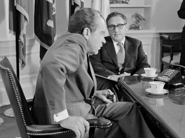 """President Nixon meets Secretary of State Henry Kissinger in the Oval Office of the White House on Oct. 9, 1973. Days before the 1972 election, Kissinger declared that peace was """"at hand"""" in Vietnam."""