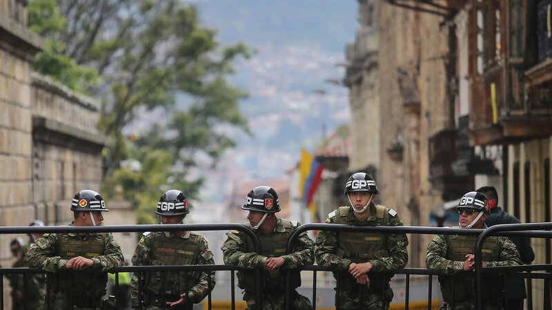 Mario Tama/Getty Images Presidential guard soldiers keep watch during the referendum on a peace accord to end the five-decade-long guerrilla war between the FARC and the state on Sunday in Bogota, Colombia. Colombian voters rejected the peace deal in a very close vote.