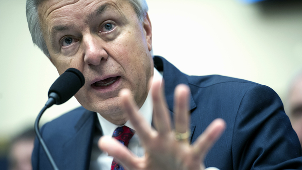 Wells Fargo CEO John Stumpf testifies on Capitol Hill in Washington on Sept. 29 before the House Financial Services Committee investigating Wells Fargo's opening of unauthorized customer accounts.