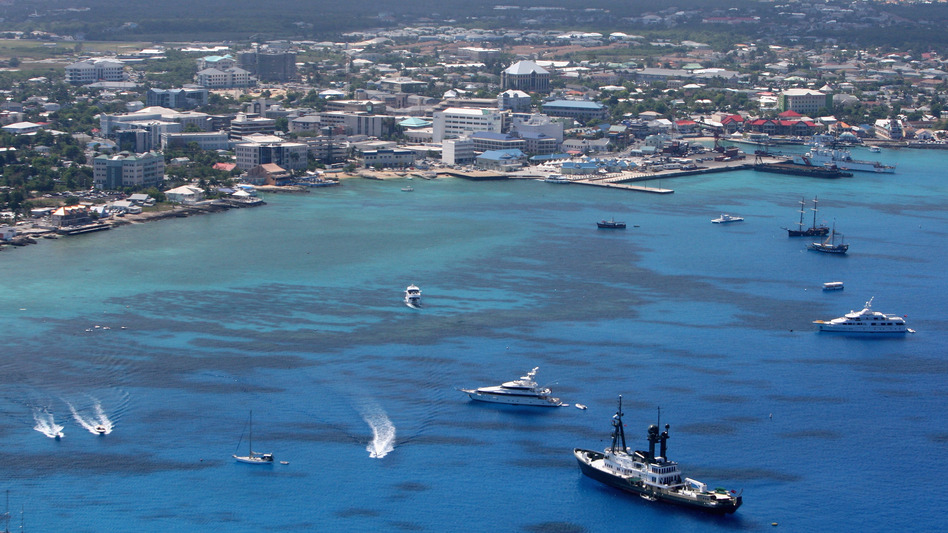 George Town in Grand Cayman, Cayman Islands, is the home of many international banks and offshore companies. A new study shows the Caymans hold $46 billion in multinational corporate profits, far more than its own $3 billion economy.
