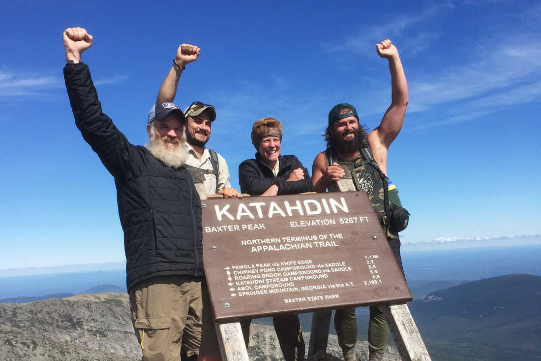(From left) Combat veterans Cody Yates, Joshua Bridger, Diana Brown and Daniel Dean at the end of the Appalachian Trail, six months after they set out from Springer Mountain in Georgia.