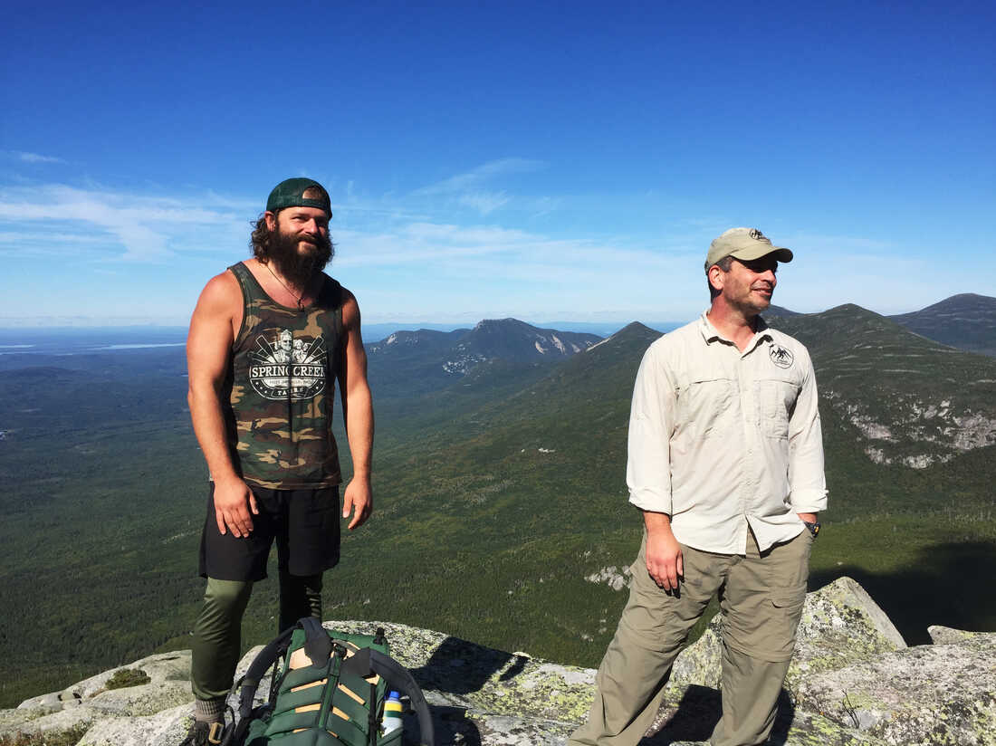 Daniel Dean (left) and Sean Gobin hike up the last few miles of the trail on Mount Katahdin in Maine. These Warrior Hikers are supported by veterans organizations.