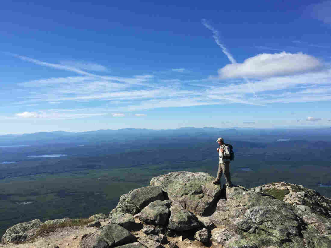 Marine Corps veteran Sean Gobin stands at the edge of the plateau on Mount Katahdin in Maine. After three combat deployments he decided to hike the 2,100-mile Appalachian Trail as a way to transition to civilian life.