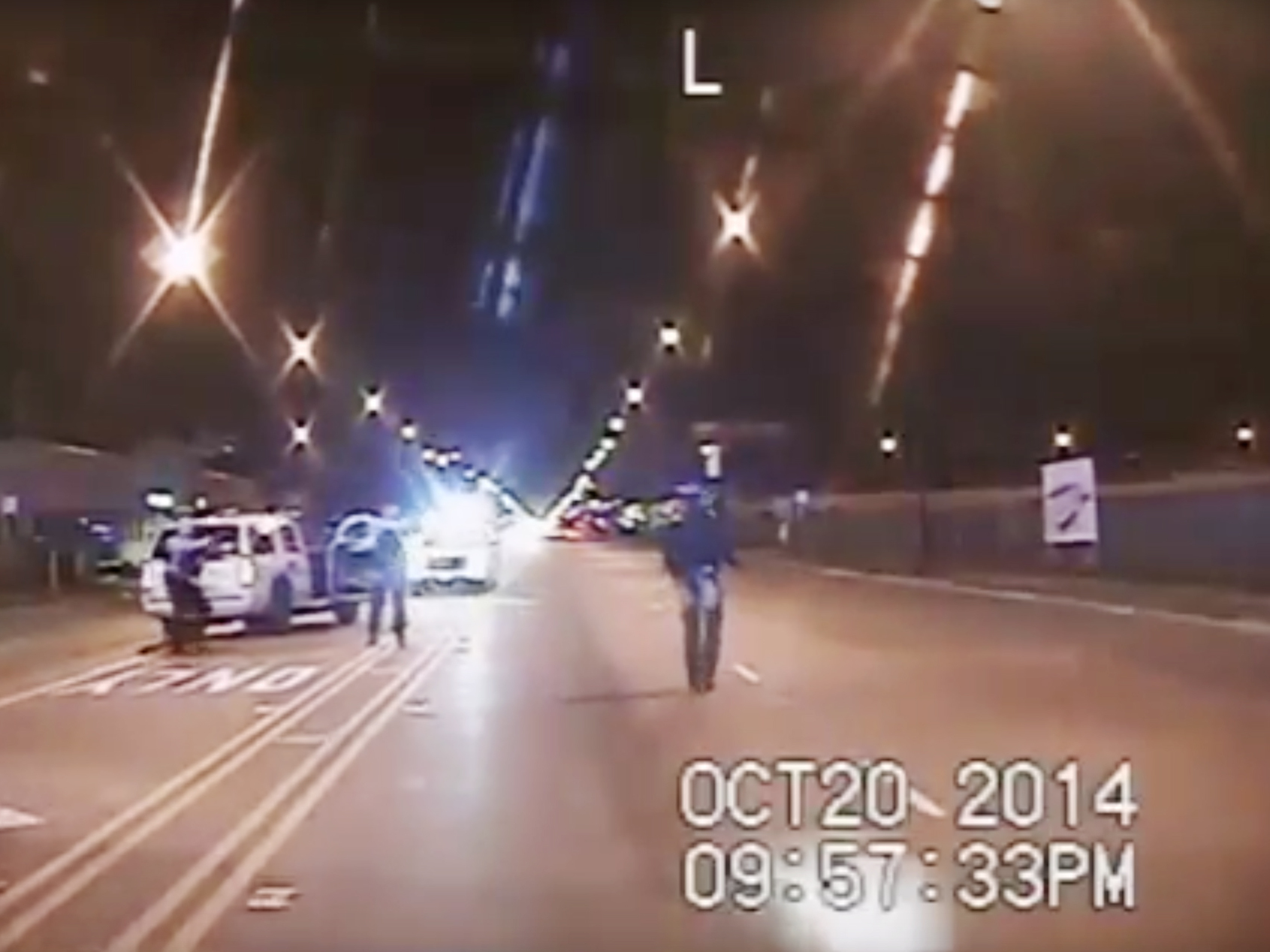 Laquan McDonald, right, walked down the street moments before being fatally shot by a police officer sixteen times in Chicago. The shooting, caught on a police video, was part of a steady drumbeat of scandals that have embroiled the city's police department in recent years.