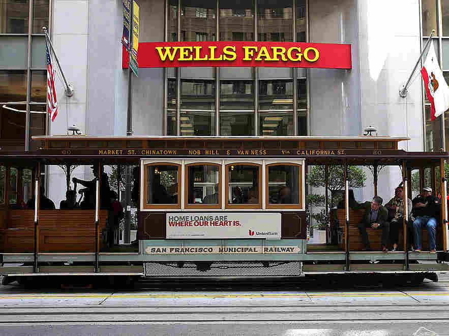 A cable car passes by a Wells Fargo bank in San Francisco, California.