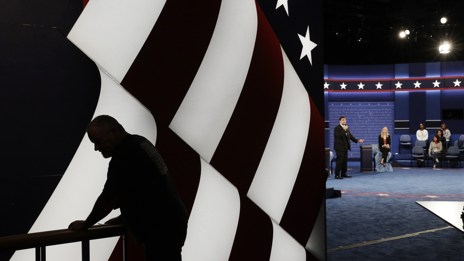 Students stand in on the stage as preparations are made for the second presidential debate at Washington University in St. Louis. (John Locher/AP)