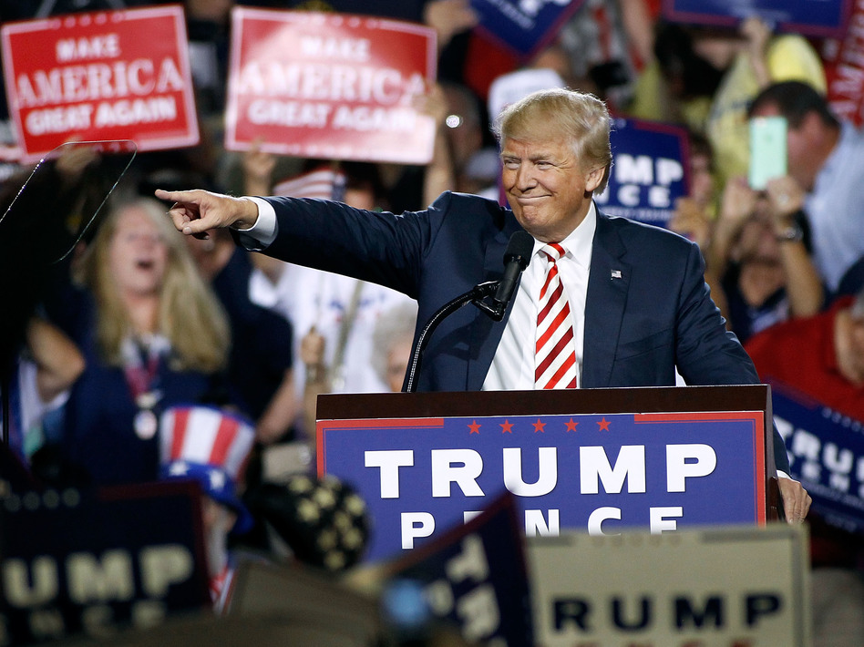 Republican presidential nominee Donald Trump points out to the crowd of supporters as he arrives at a campaign rally on Oct. 4, 2016 in Prescott Valley, Arizona. (Ralph Freso/Getty Images)