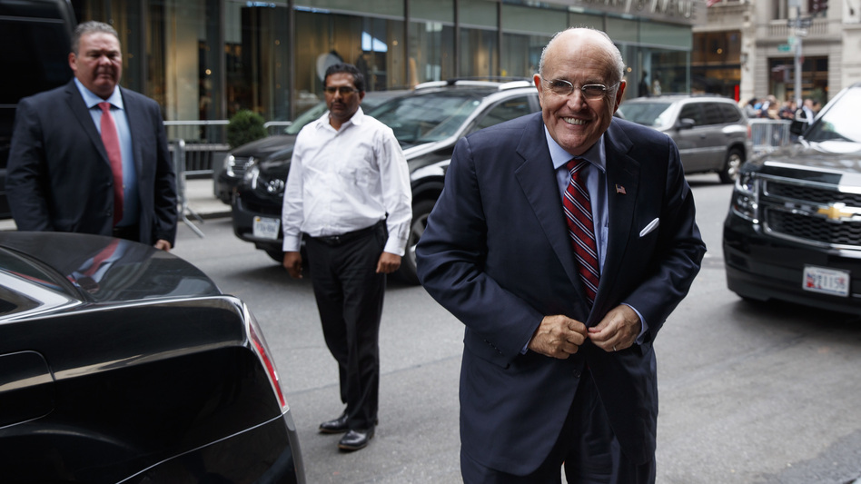 Former New York mayor Rudy Giuliani arrives at Trump Tower Saturday to strategize with Donald Trump over how to handle tapes capturing the GOP nominee making lewd statements about women (Evan Vucci/AP)