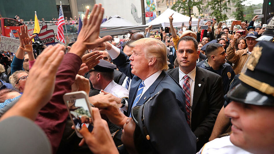 Donald Trump greets supporters outside of Trump Towers in Manhattan October 8, 2016 after a 2005 video revealed lewd comments Trump made about women. (Spencer Platt/Getty Images)