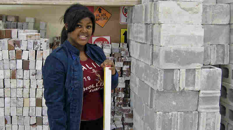 Kyrah Whatley, 17, is confident she can become a mason after finishing high school. But around the U.S., many parents think schools are not adequately preparing girls for the workforce.