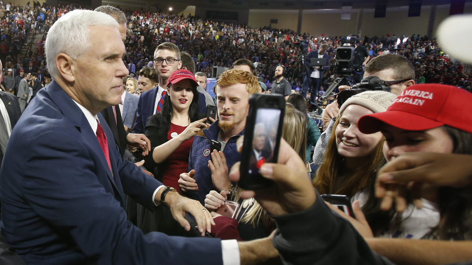 Republican vice presidential nominee Mike Pence, left, shakes the hands of supporters after a speech at Liberty University in Lynchburg, Va., on Oct. 12. (Steve Helber/AP)