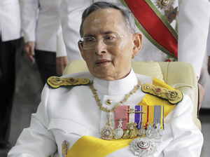 Thailand's King Bhumibol Adulyadej is pushed in a wheelchair while leaving Bangkok's Siriraj Hospital for the Grand Palace for a ceremony celebrating his birthday in 2011.