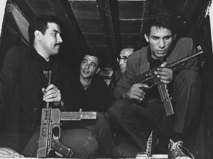 Saadi Yacef, as revolutionary leader El-hadi Jaffar (second from left) and Brahim Haggiag (right) as revolutionary leader Ali La Pointe in a scene from Gillo Pontecorvo's The Battle Of Algiers.