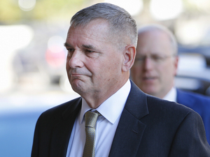 Retired Marine Gen. James E. Cartwright arrives at U.S. District Court in Washington on Monday. Cartwright pleaded guilty to a single count of making false statements to federal investigators seeking the source of a leak of classified information.