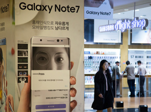 A woman walks past an ad for the Samsung Galaxy Note 7 smartphone at the company's flagship store in Seoul.