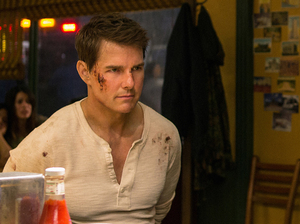 Tom Cruise plays Jack Reacher (from left), Judd Lormand plays Local Deputy and Jason Douglas plays Sheriff in Jack Reacher: Never Go Back.