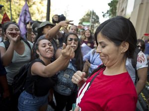Demonstrators in favor of abortion rights (left) shout at an anti-abortion activist at a rally in in Santiago, Chile, on March 21. Chile is one of the few countries that bans abortion in all circumstances. Lawmakers are working on a measure that would allow abortions in some cases. But many religious conservatives say the current law should remain.