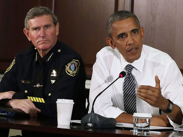 President Obama speaks alongside Terry Cunningham of the International Association of Chiefs of Police during a conversation on community policing and criminal justice in July in Washington, D.C.