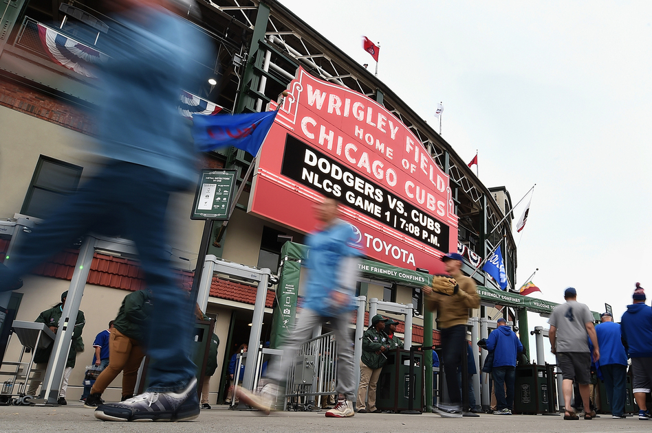 Fans walk outside Chicago's Wrigley Field prior to Game 1 of the National League Championship Series between the Chicago Cubs and the Los Angeles Dodgers on Oct. 15. (Stacy Revere/Getty Images)