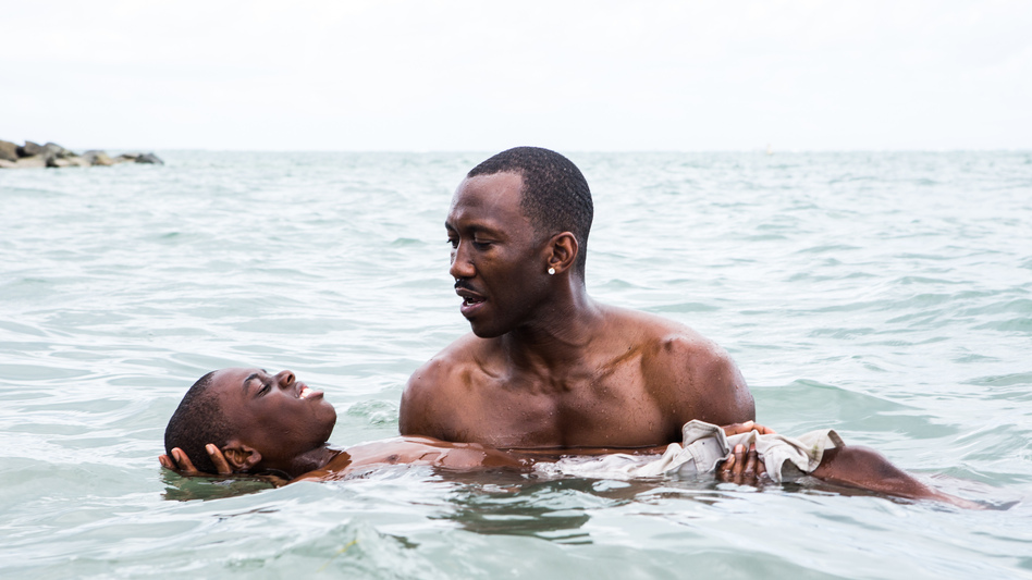 Juan (played by Mahershala Ali) teaches Chiron (Jaden Piner) how to swim in <em>Moonlight</em>. The film is told with different actors playing Chiron at different stages of his life. (David Bornfriend/A24 Films)