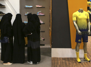 Saudi women shop at a mall in Riyadh last December. With oil prices down, the kingdom is trying hard to reform its economy and attract outside investment.