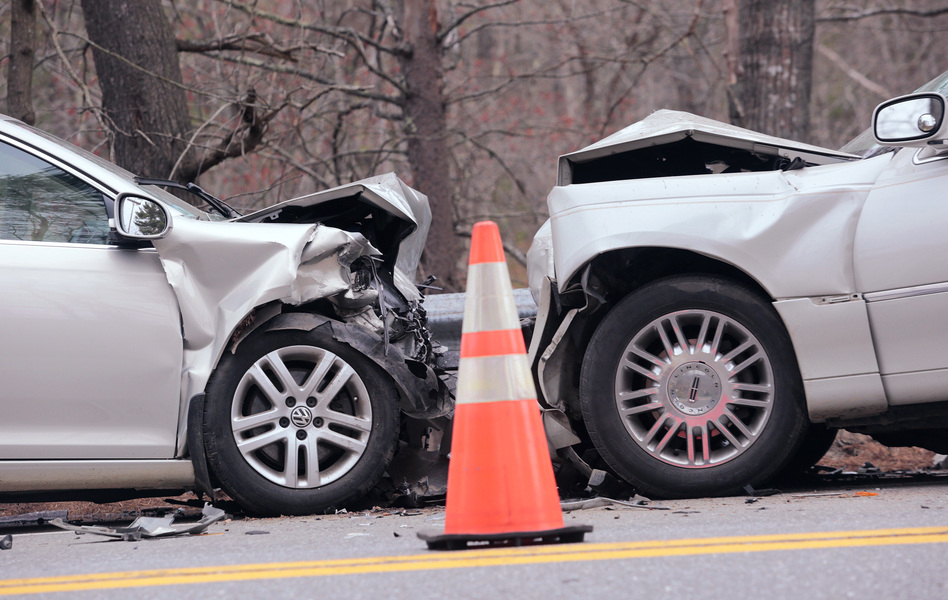 Officials investigate a fatal head-on collision on Route 1 at the town line of Wiscasset and Woolwich in Maine in May. (Derek Davis/Press Herald via Getty Images)