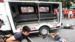 Police Van Rams Protesters At Anti-U.S. Demonstration In Philippines