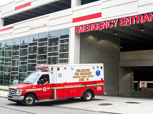 An ambulance pulls out of the emergency entrance at Temple University Hospital in North Philadelphia.