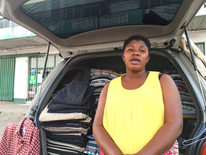 Fortunate Nyakupinda earns a living by selling secondhand clothes from the back of her car.