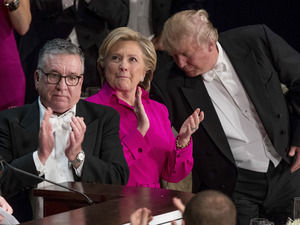 Alfred E. Smith IV (left), Democratic presidential nominee Hillary Clinton and Republican presidential nominee Donald Trump stand to applaud during the 71st annual Alfred E. Smith Memorial Foundation Dinner in New York City.