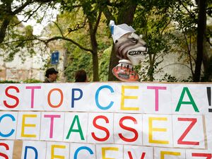 "A banner reads ""Stop CETA - it's enough"" during a protest in front the Walloon parliament in Namur, Belgium, during a meeting on the EU-Canada Comprehensive Economic and Trade Agreement."