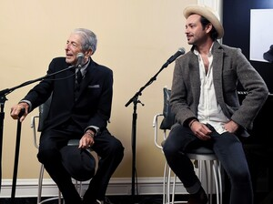 Leonard Cohen (left) and Adam Cohen speak at an event for the release of You Want It Darker.