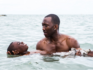 Juan (played by Mahershala Ali) teaches Chiron (Jaden Piner) how to swim in Moonlight. The film is told with different actors playing Chiron at different stages of his life.