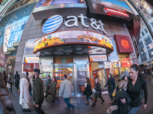 AT&T is buying Time Warner in a massive merger that would create a mammoth media and telecom company.