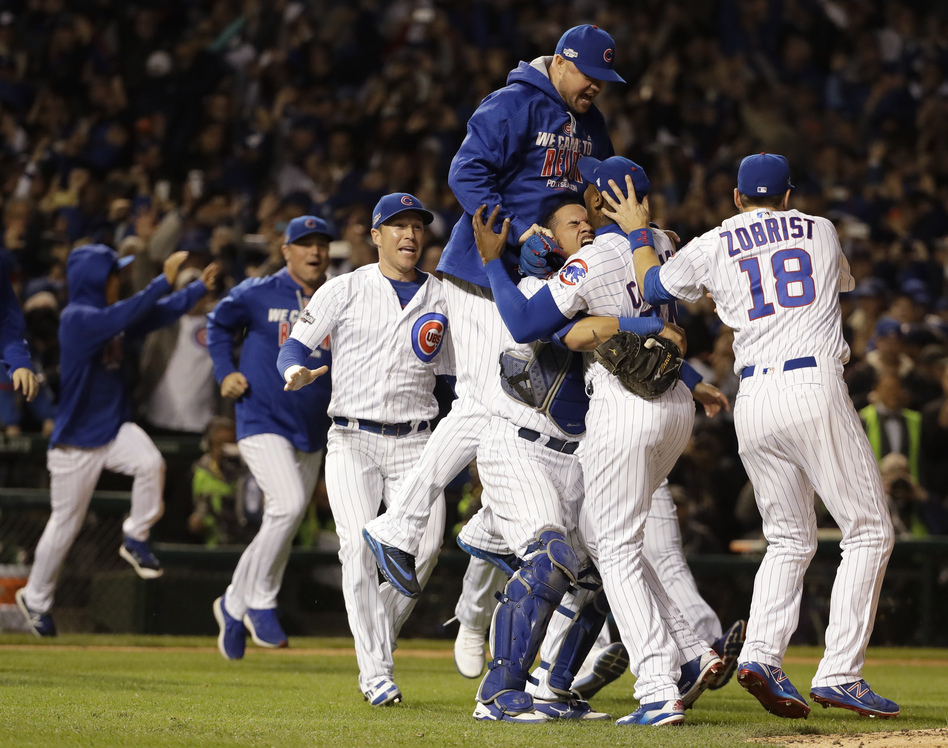Chicago Cubs players celebrate after Game 6 of the National League baseball championship series against the Los Angeles Dodgers, Saturday, in Chicago. (David J. Phillip/AP)