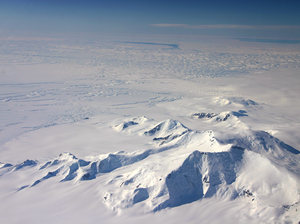 This image taken in 2012 shows part of the Crosson Ice Shelf (center left) and Mount Murphy (foreground) in western Antarctica. Thwaites Ice Shelf lies beyond the highly fractured expanse of ice (center).