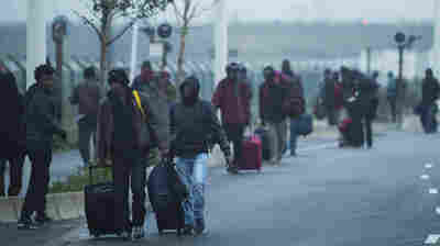 PHOTOS: France Begins Evicting Thousands Of Migrants From Notorious 'Jungle' Camp