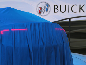 A Buick awaits unveiling at the 2015 Los Angeles Auto Show. The brand, a sales leader in China, is tops in terms of reliability according to Consumer Reports.