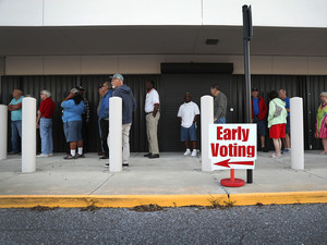 Voters line up to vote early at the Supervisor of Elections Office in Bradenton, Fla., on Monday. Multiple House districts in the state could flip for the opposite part in this election.