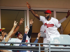 Clevelanders, including LeBron James of the NBA Cavaliers, are psyched about the Indians' post-season success. James is seen at Game 2 of baseball's AL Championship Series between the Indians and the Toronto Blue Jays in Cleveland.