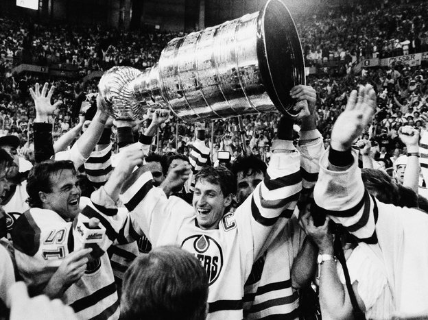 Wayne Gretzky is flanked by his Edmonton Oilers teammates after winning the Stanley Cup over the Philadelphia Flyers in May 1987.