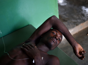 A young Haitian suffering from cholera symptoms receives medical attention Saturday at Saint Antoine Hospital of Jeremie in southwestern Haiti.