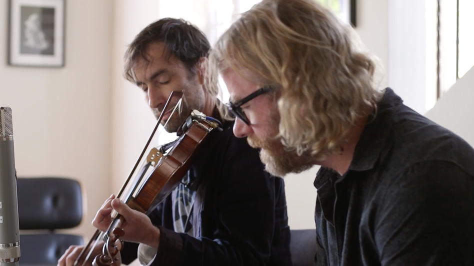 Andrew Bird and The National's Matt Berninger perform together in Bird's living room. (Courtesy of the artists)
