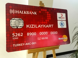 The debit card the European Union is funding for 1 million Syrian refugees in Turkey, shown in a mock-up, would provide about $30 per person per month to each family member. The idea is to help the refugees in Turkey and keep them from going to countries in Europe.
