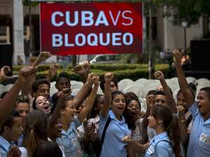 Students in Havana cheer on Wednesday at news that the United Nations General Assembly voted 191-0, with two abstentions, on the Cuba embargo resolution.